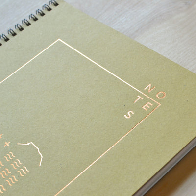 Revel Paper notebook cover with copper foil design.