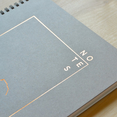 Shale gray cover and metallic copper foil. Revel Paper for the modern desk.
