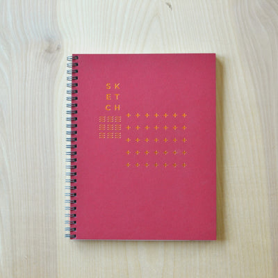 Crimson sketch book with copper foil cover. Revel Paper for the modern desk.