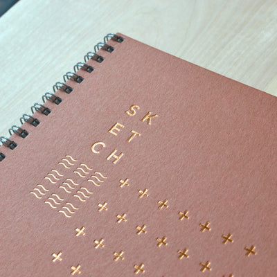 Copper foil and rich, warm brown cover