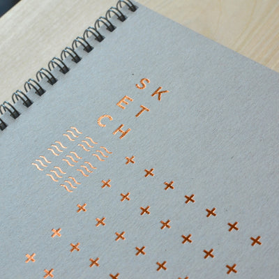 Copper foil modern design on a gray cover. Revel Paper for the modern desk.
