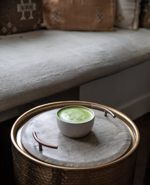 Matcha Supreme on a table in the window seat of the Firepot Tea Bar