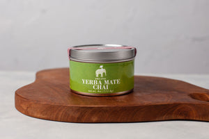 3oz tin of yerba mate chai on a wooden board
