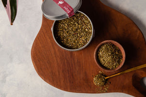 3oz tin of yerba mate chai loose leaf on a wooden board