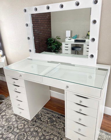 Glass top vanity with drawers