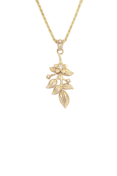 14 karat yellow gold flower necklace with leaves, floral, diamonds, and 1mm adjustable rope chain