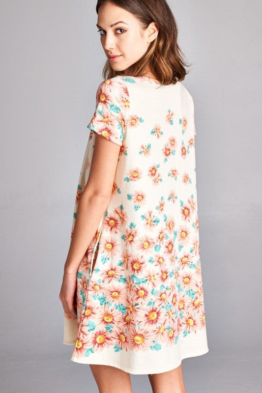 American made women's tunic dress in daisy print back view closeup