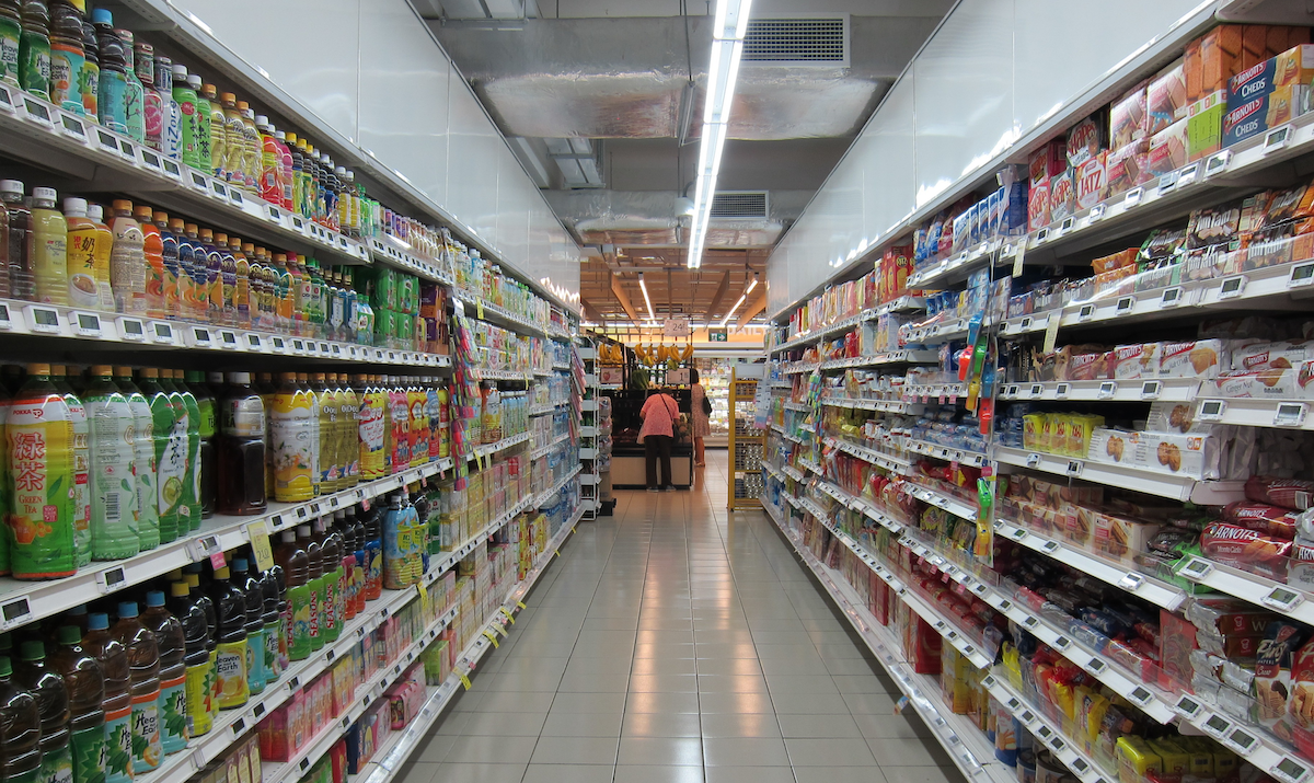 A grocery aisle lined with junk food