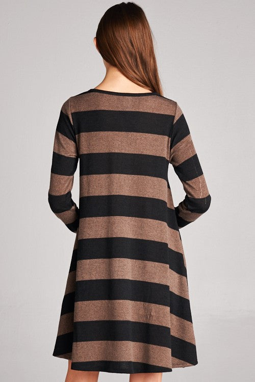 Long sleeve stripe tunic dress with hidden front pocket. Mocha colored tunic with thick horizontal burgundy stripes.