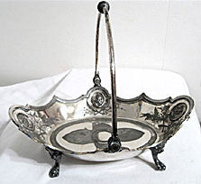 "Medalliion - Silver Plate - Cake / Bread Basket - w/ Swing Handle - Figural - Heads & Paw Feet -  11"" x 9"""