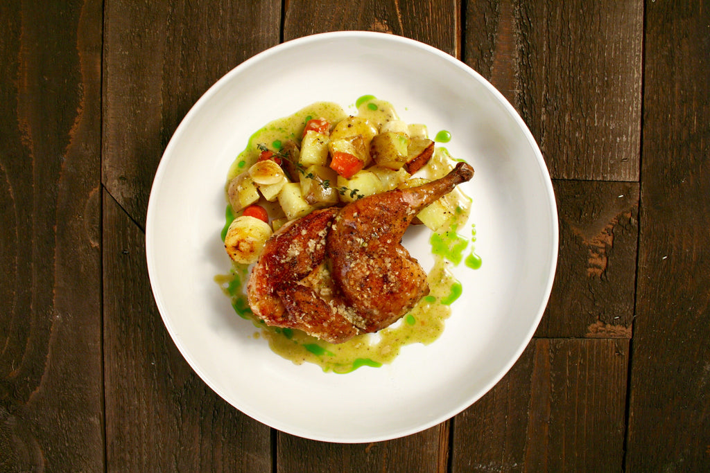 Brick Cornish Hen with Yukon Golds, Garlic and a Shallot Pan Sauce