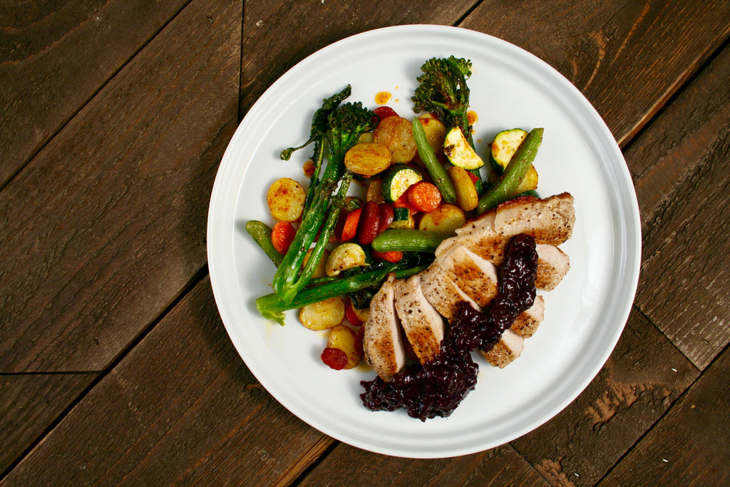 Seared Pork Loin with Blueberry Tamarind Chutney and Seasonal Vegetables