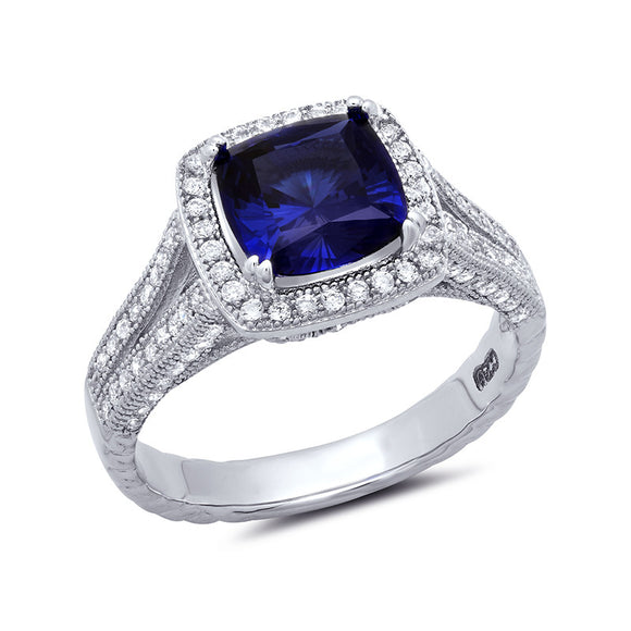 Royal blue cushion cut halo with lab grown sapphire ring. - Zaitano
