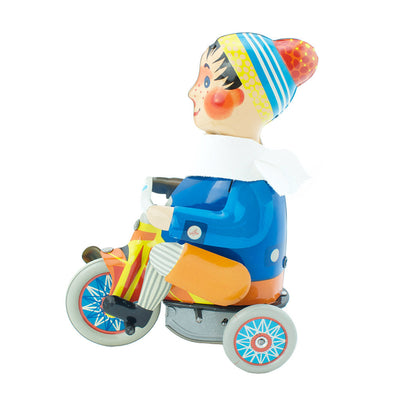 Wind up boy on tricycle tin toy