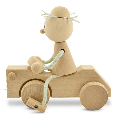 wooden pull along boy with tractor toy