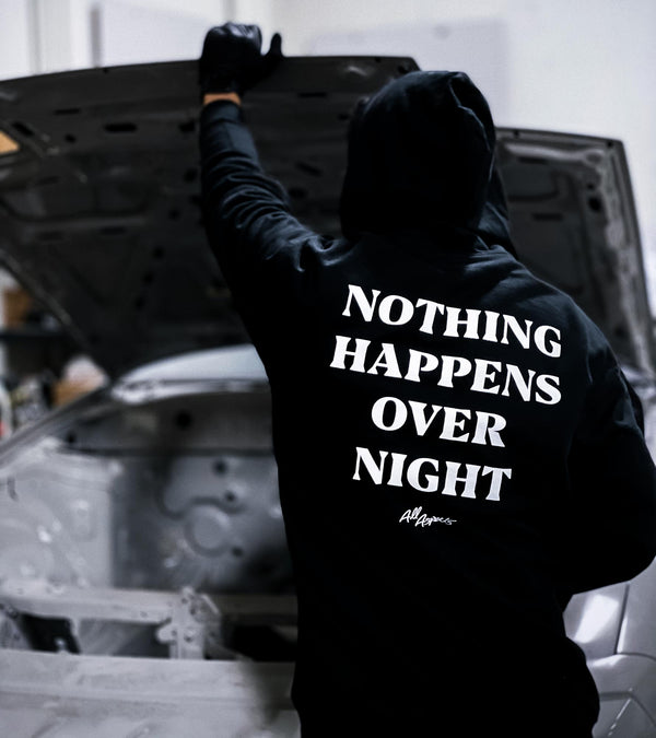 Nothing Happens Overnight Hoodie - Black