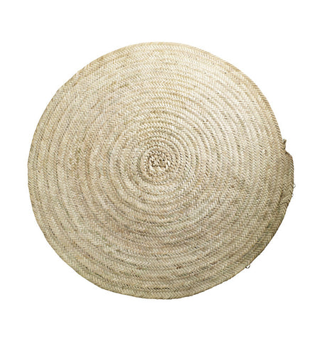 Round carpet in palm leaves