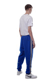 REFLECTIVE EMBLEM TRACK PANTS | BLUE - SALES