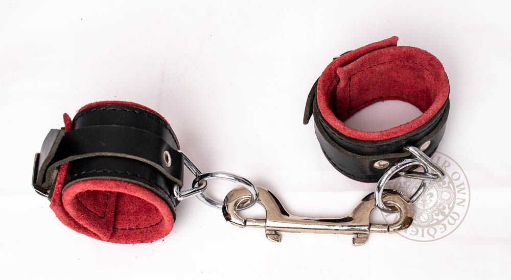 Bondage Leather Handcuffs in black and red for BDSM and fetish play