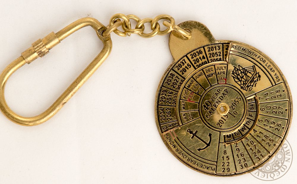 Calendar key ring made from brass with image of anchor and ship