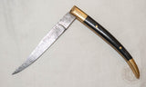 Medieval damascus folding knife with horn and brass handle