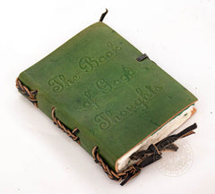Small leather diary with the book of good thoughts written on cover