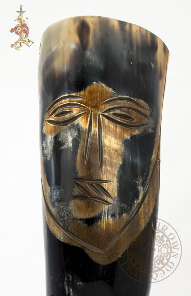 Viking drinking horn with carved rune face
