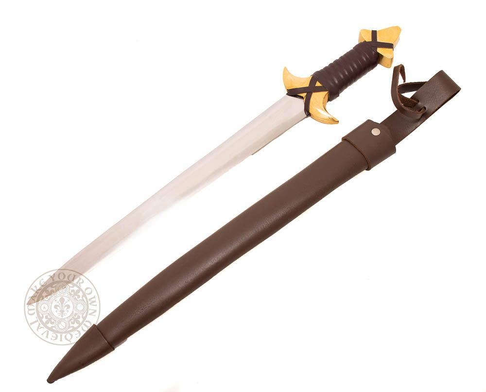 fantasy dagger with brass hilt and pommel and leather scabbard