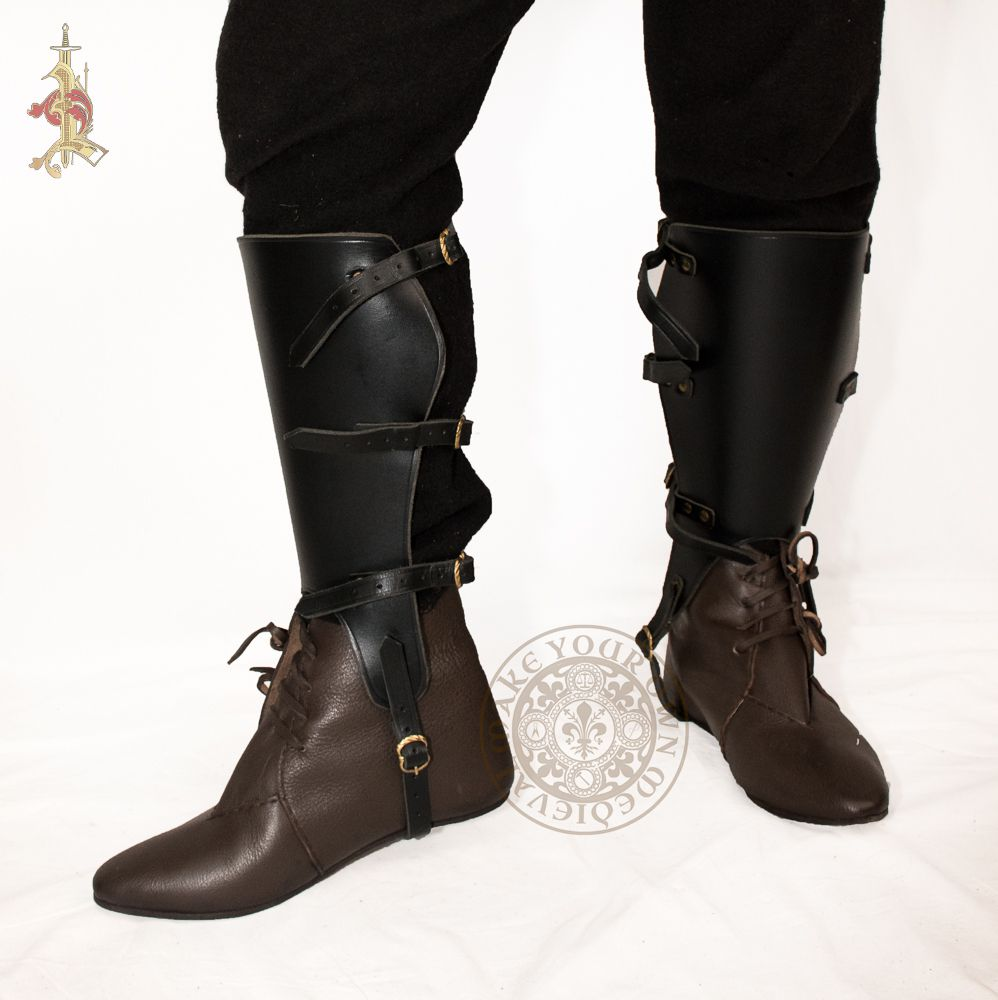 leather larp greaves armour in black with brass buckles