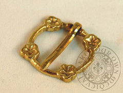 medieval annular brooch clasp with four flowers