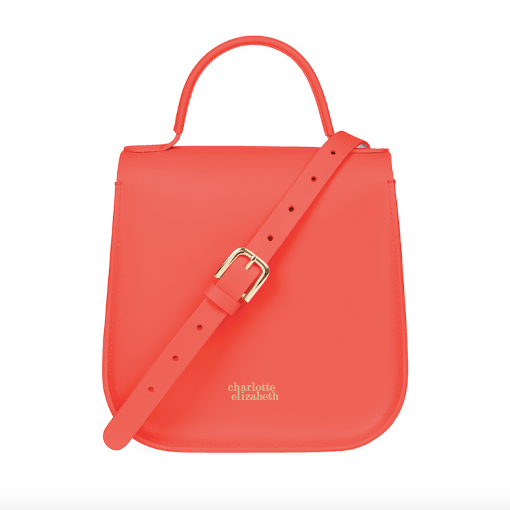 coral handbag with cross body strap and gold detail