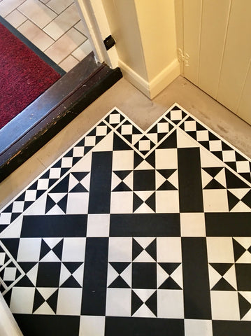 black and white tiles in corner