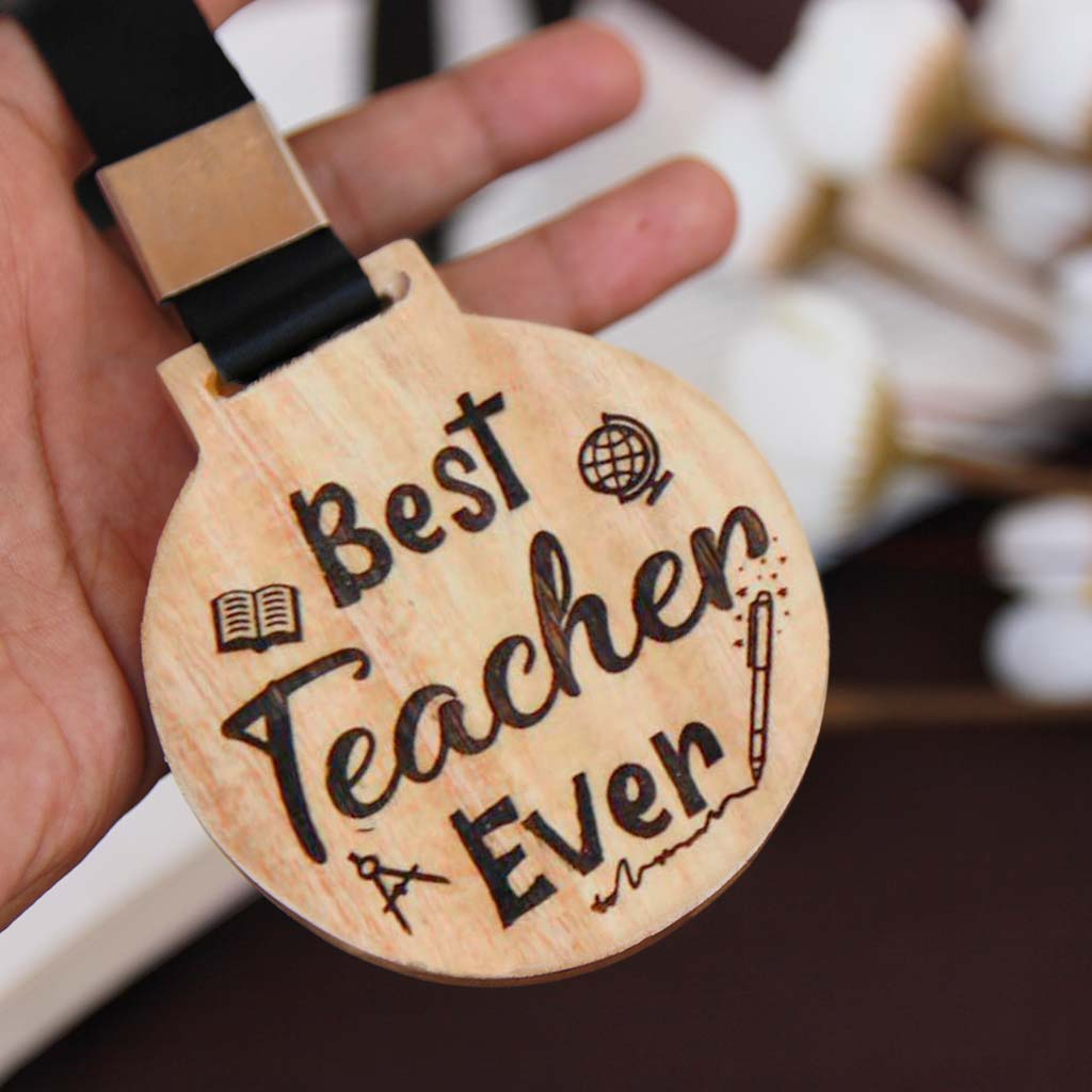Best Teacher Ever Personalized Wooden Medal. Personalize this unique Best Teacher Ever custom medal with a teacher's name at the back of the medal. Looking for Teacher's Day gifts? This personalized wooden medal will make the perfect gift for your favorite teacher.