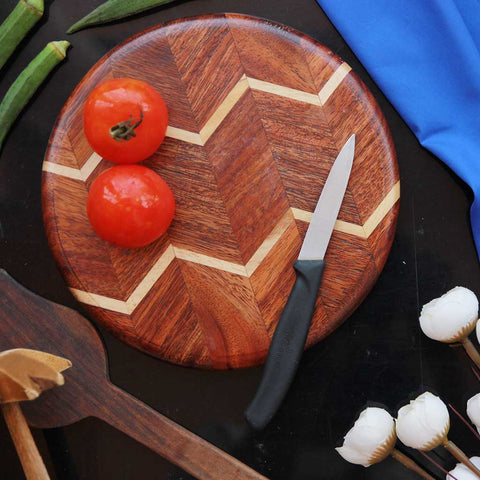 Chevron Pattern Round Wooden Chopping Board. This Round Cutting Board Makes One Of The Best Anniversary Gift Ideas. Shop More Personalized Gifts For Him And Her On Your 5th Wedding Anniversary.