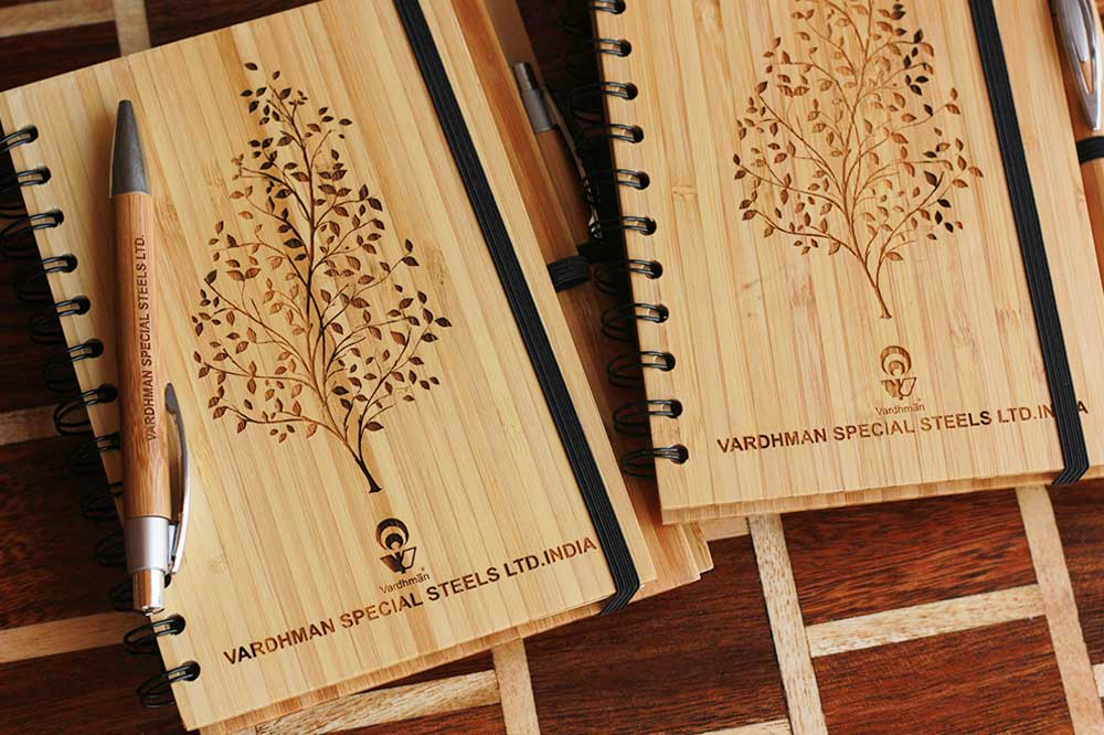 Custom Wooden Notebooks As Personalized Corporate Gifts For Vardhman Special Steels Ltd. India. Best Corporate Gifts for Employees and Promotional gifts for clients.