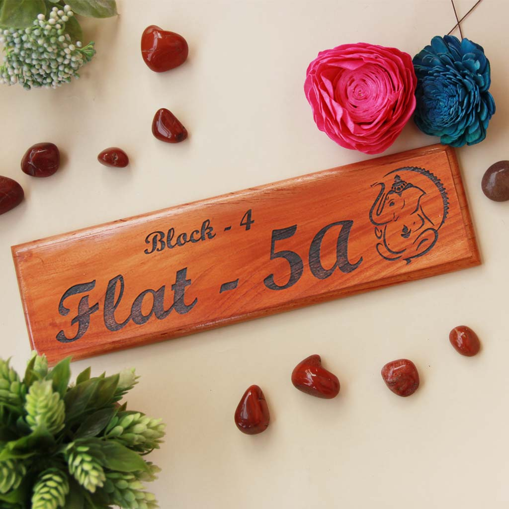 Ganesh Name Plate As Return Gifts For Ganesh Chaturthi. This Personalized Name Plate With Flat Number Is The Best Ganesh Chaturthi Gifts. Looking for Gifts Online? This Wooden Name Plate Makes A Perfect Festival Gift. This Wooden Door Nameplate Makes An Auspicious Gift For Family.