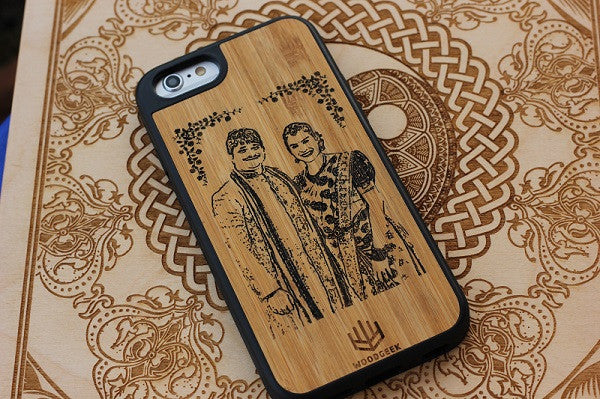 A wooden iPhone case engraved with a couple photo