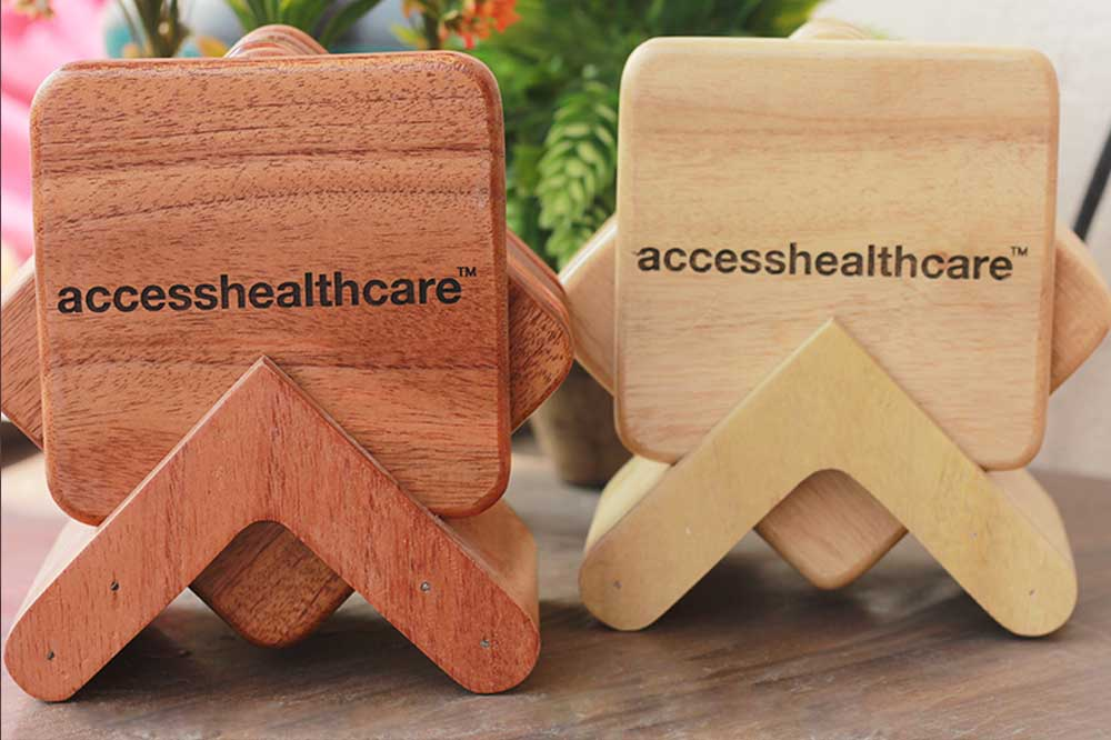 Wooden Coasters as Personalized Corporate Gifts for Access Healthcare. The Best Business Promotional Gifts for Clients. Get Wholesale Rates for Bulk Orders of Corporate Gifts at Woodgeek Store