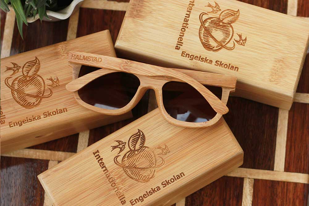 Wooden Sunglasses As Corporate Gifts for Internationella Engelska Skolan, Halmstad, Sweden. Custom Sunglasses engraved with company name as promotional gifts. These bamboo sunglasses come with a bamboo sunglasses case engraved with client's name and your company logo. Sunglasses make unique corporate gift ideas.