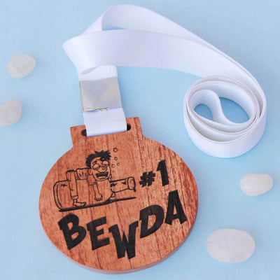 #1 Bewda Wooden Medal With Ribbon. This Funny Medal Is Engraved On Mahogany or Birch Wood. These Funny Medals Make Great Friendship Day Gifts Or A Simple Birthday Gift For Friends.