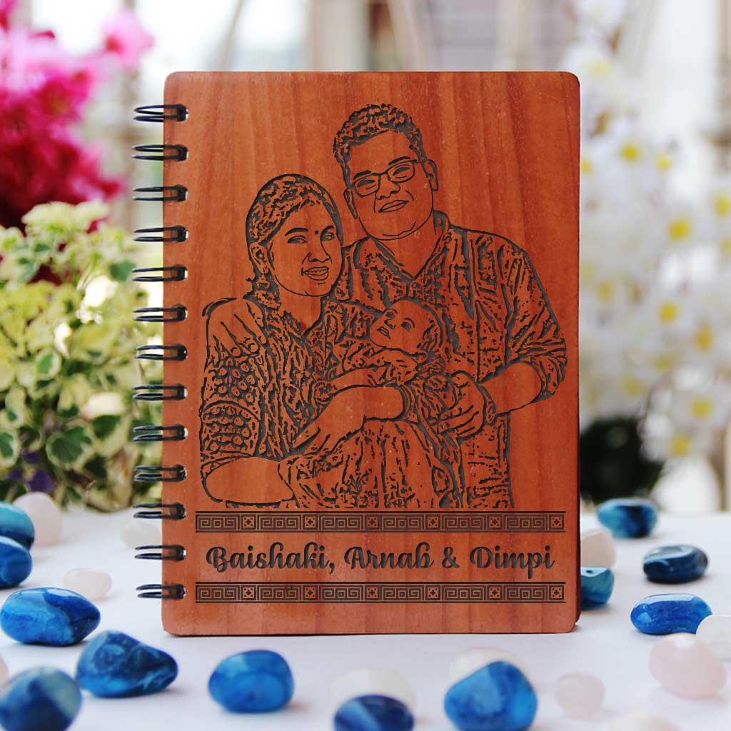 Baby journal engraved with photo. Looking for gifts for new parents? This baby memory book engraved with a photo is one of the best new mum and dad gifts.