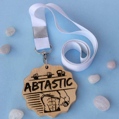 Abtastic Engraved Medal. This Is The Best Gift For Fitness Lovers. Buy More Customised Gifts For Fitness Enthusiasts From The Woodgeek Store.