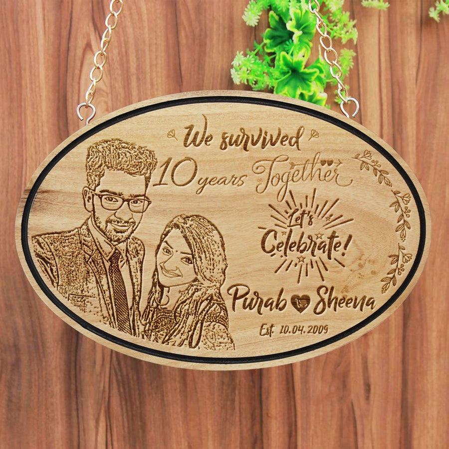 We Survived Funny Anniversary Wishes Engraved On Hanging Wooden Sign. This wood engraved photo is makes great photo gifts. This Personalized Wooden Plaque Is A Funny Anniversary Gift For Him And Her - These Hanging Name Signs Also Make Great Party Accessories For Anniversary Parties.