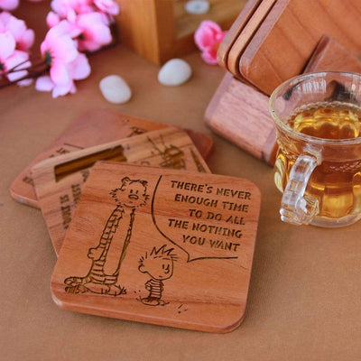 Calvin and Hobbes - Wooden Coaster Set With Holder. Gift coasters engraved with Calvin and Hobbes quotes. This coaster set is the best engraved wooden coasters and funky coaster which can be used as tea coaster and coffee coaster. This square coaster and natural wood coaster is one of the best gifts for Calvin and Hobbes fans.