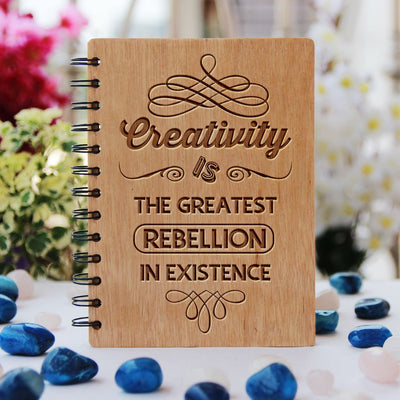 Creativity is the greatest rebellion in existence - bamboo wood notebook
