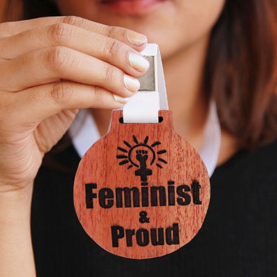 Feminist & Proud Wooden Medal With Ribbon - This Is A Feminist Pin To Wear Proudly - It is a great gift for a feminist friend and the best gifts for women.
