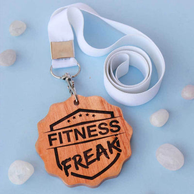 Fitness Freak Engraved Medal. A funny award for the fitness freak of your life. This wooden medal makes funny gift ideas for fitness lovers.
