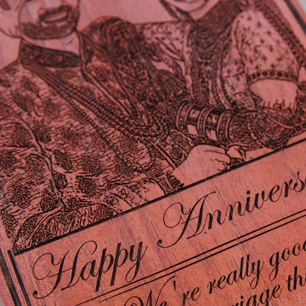 Happy Anniversary: We're really good at this marriage thing wood engraved photo. A photo on wood along with carved funny anniversary wishes. This photo gift is the best anniversary gift for husband or wife.