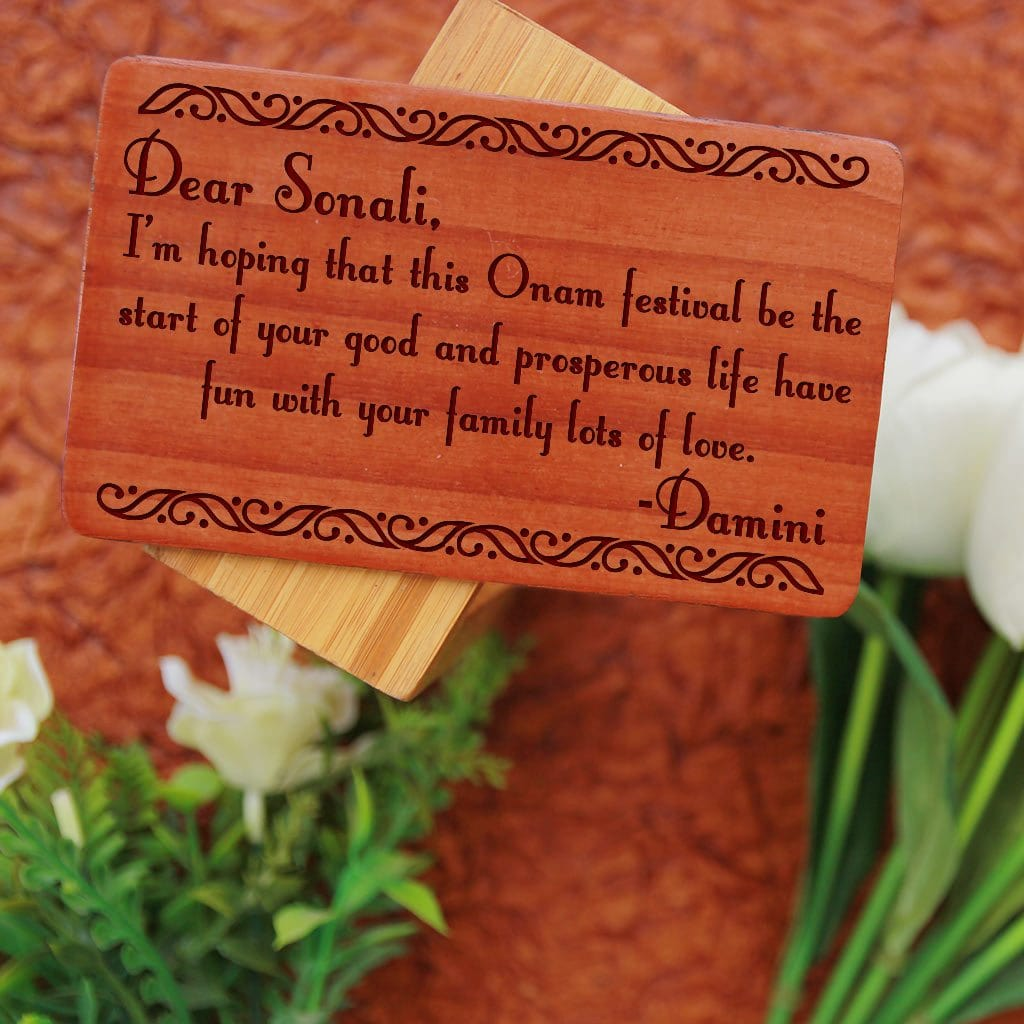 Onam Wishes Engraved On Wooden Greeting Cards. These Personalized Wooden Cards Are Great Onam Gifts. Send Wishes And Onam Greetings With Wooden Cards Online.