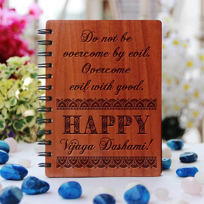 Don't be overcome by evil. Overcome evil with good. Happy Vijaya Dashami! Vijaya Dashami Wishes Engraved On Wooden Notebook. Looking for durga puja gift ideas? This wooden diary is the best durga puja gift, navratri gifts and dussehra gift.